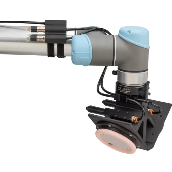Dual head vacuum gripper for grinding flash from molded part